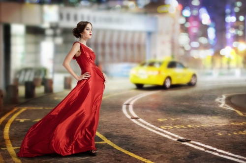 Young Beauty Famous Woman In Fluttering Red Dress Outdoor